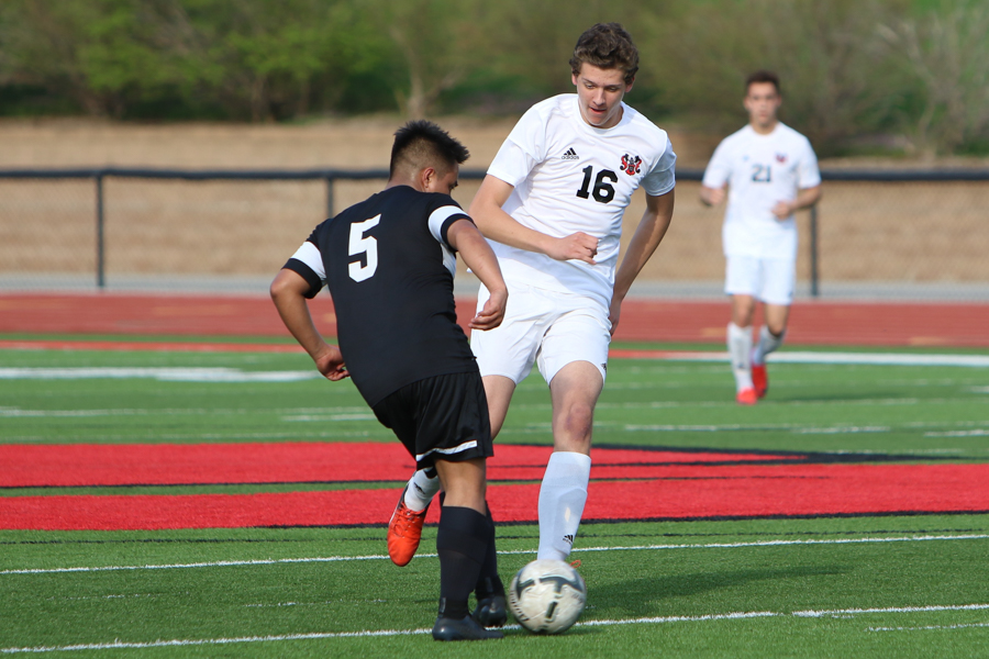 Sophomore+Miltiadis+%28Milton%29+Hatzidakis+goes+in+to+tackle+an+Omaha+South+player.+Hatzidakis+scored+Westside%27s+second+goal+against+Omaha+South.+
