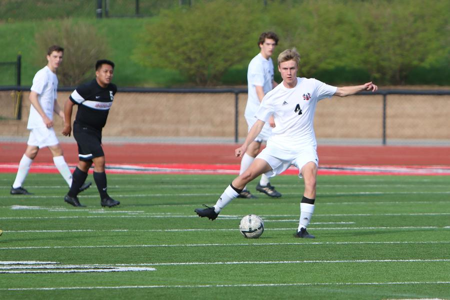 Senior+Christian+Hanus+passes+the+ball.+