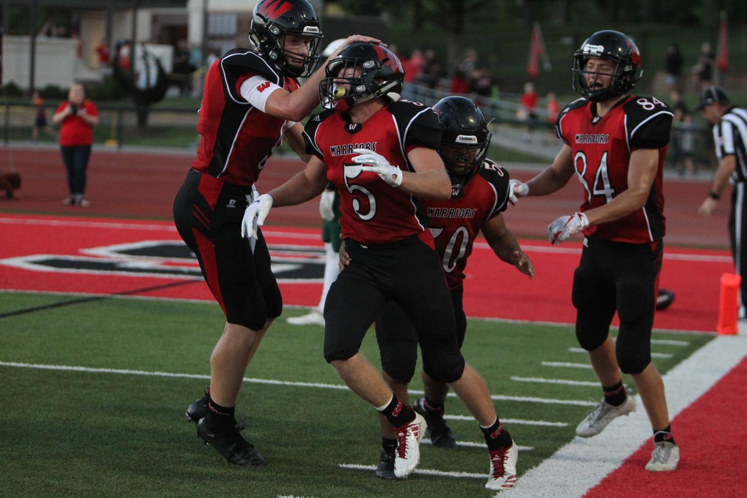 Senior Dylan Packett and his teammates celebrate a touchdown earlier in the season.