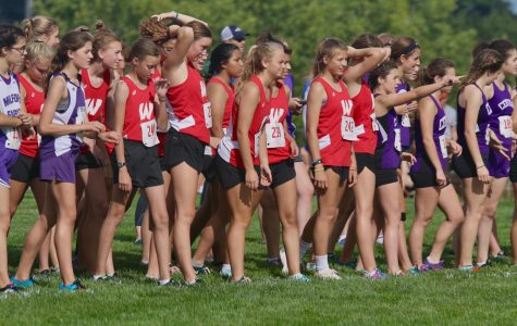 The Westside Girls Cross Country team lines up prior to a meet earlier this season.