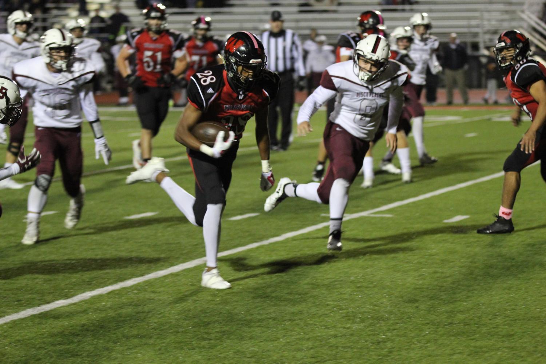 Sophomore Avante Dickerson evades defenders against Columbus in week eight.
