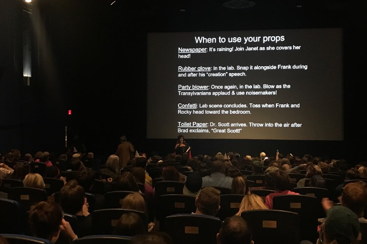 The audience at Dundee Theater learns how to use props for their screening of Rocky Horror Picture Show.