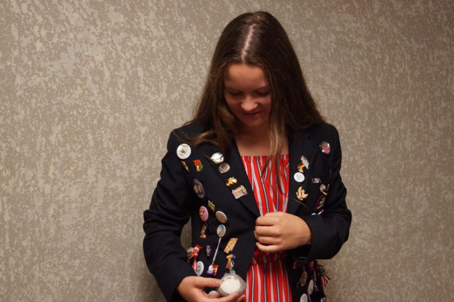 Sophomore Jule Wessels talks about her Rotary Jacket. Photo by Eleanor Dodge