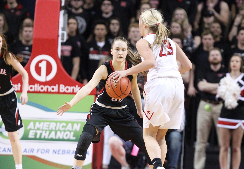 Junior Ella Wedergren defends Millard South's Bailey Urban during the state championship last season.