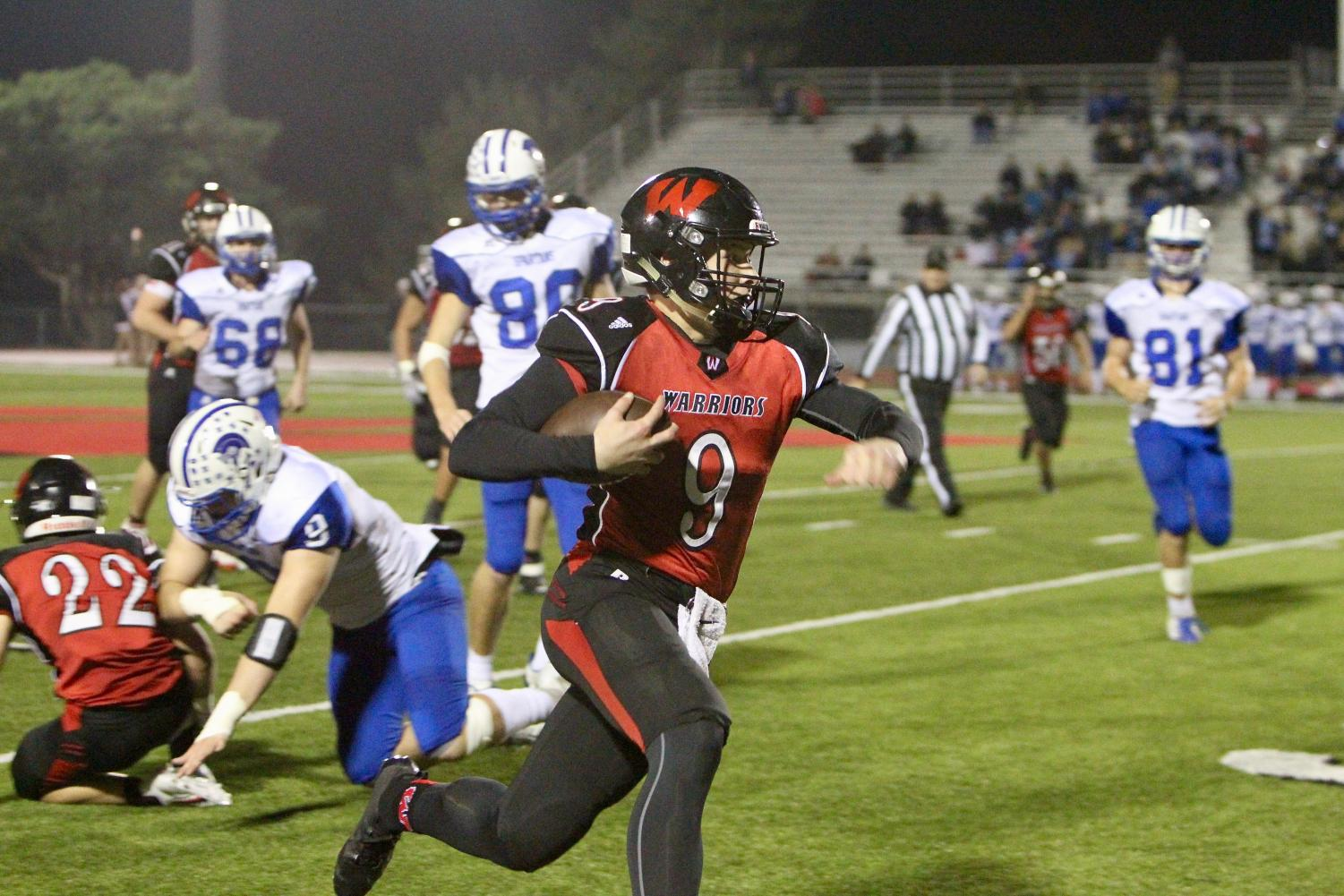 Sophomore Cole Payton rushes during Westside's first round matchup with Lincoln East.