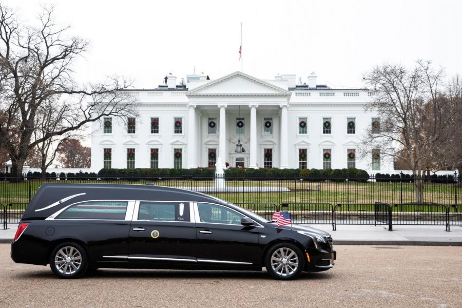 A White House funeral coach drives past the White House in Washington D.C.