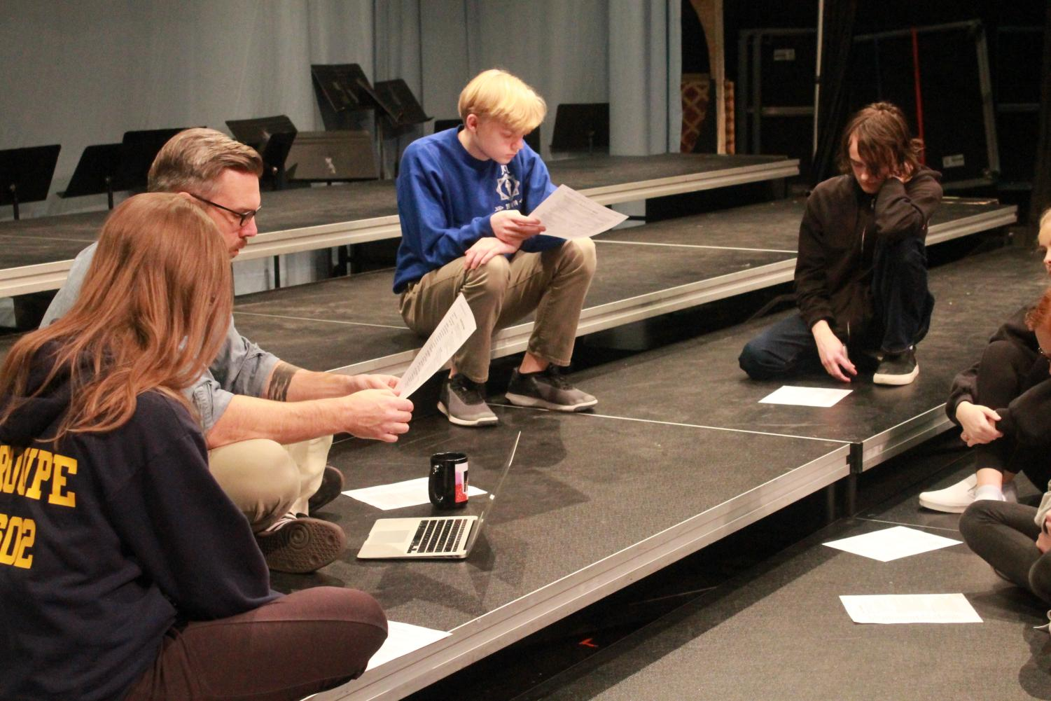 Students+of+Devised+Theater+go+over+their+syllabus