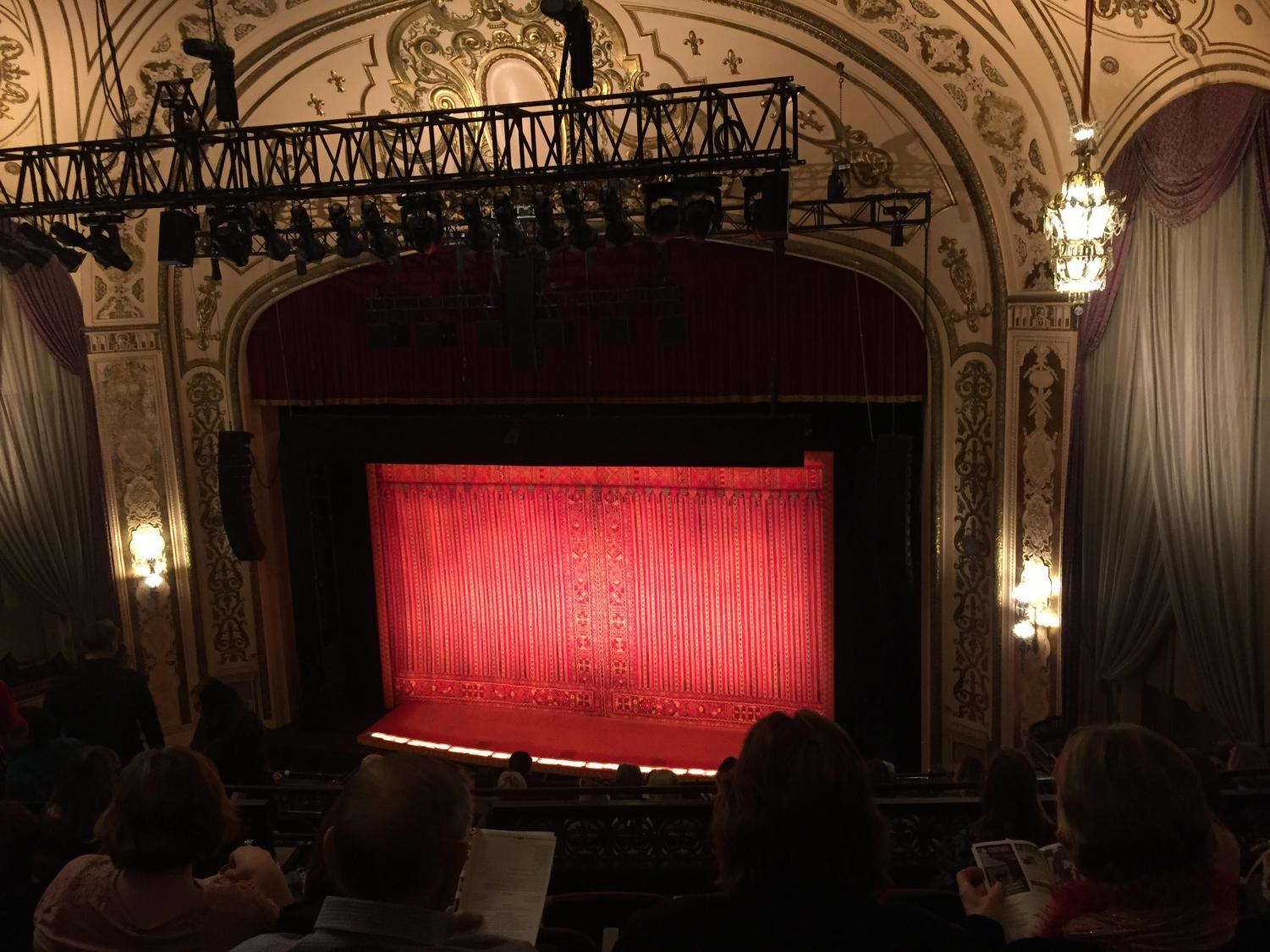 The quilt-like curtain displayed before the show.