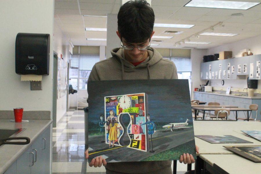Art student Daniel Wood displays one of his award winning pieces.