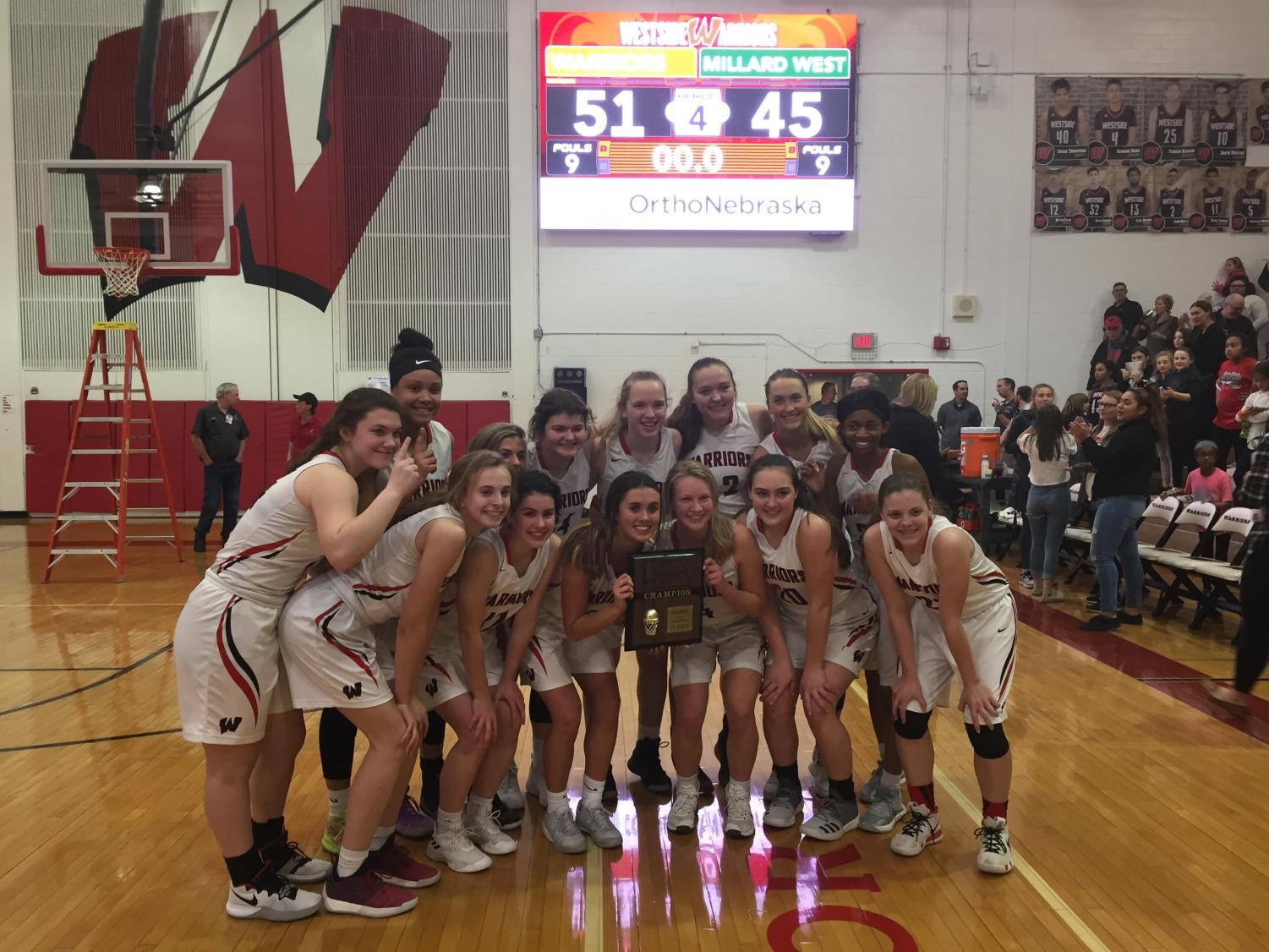The girls received a plaque after winning the district A-5 title.