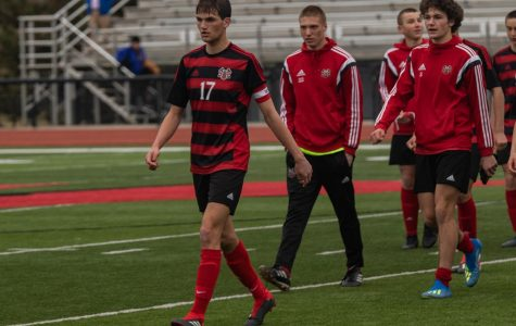 Senior Ethan Goldner leads his team following an early season loss to Omaha Creighton Prep.
