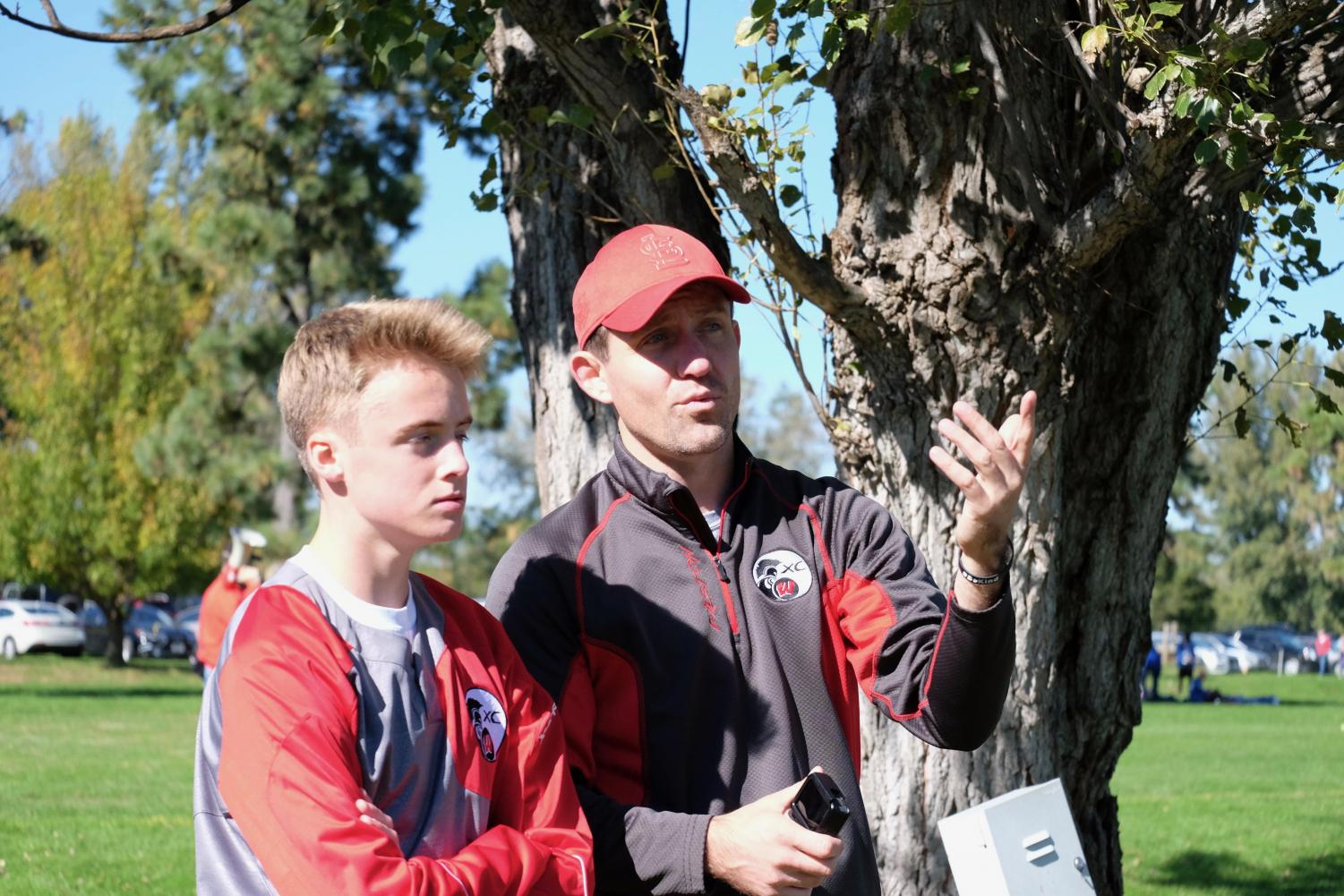 Junior Jacob Caffey discusses with boys head coach Andrew Easton.