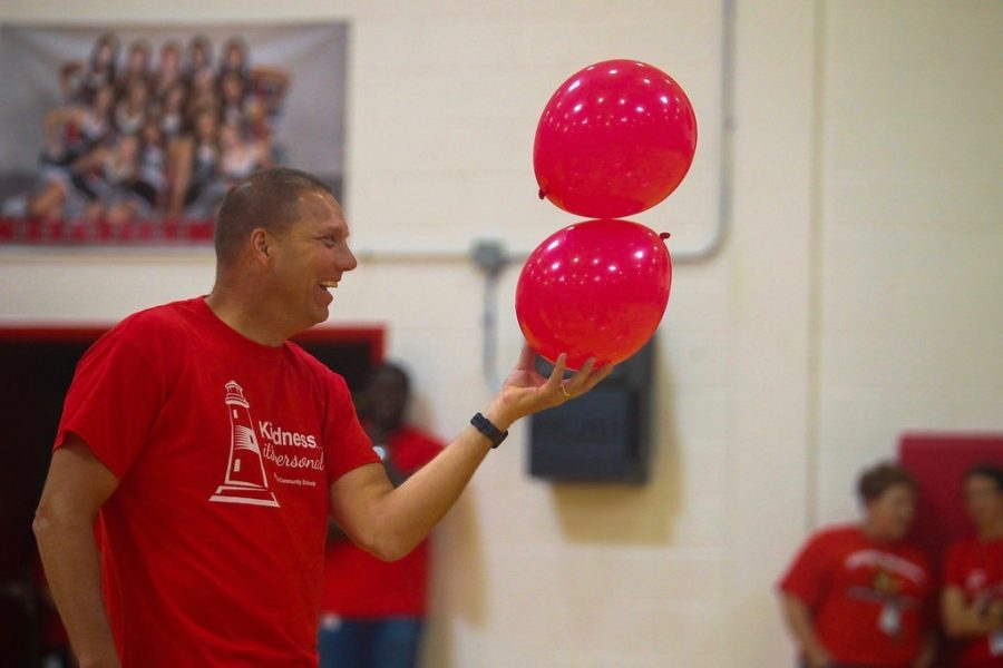 Counselor Ted Dondlinger wears a 'Kindness...it's personal' shirt during freshmen orientation.