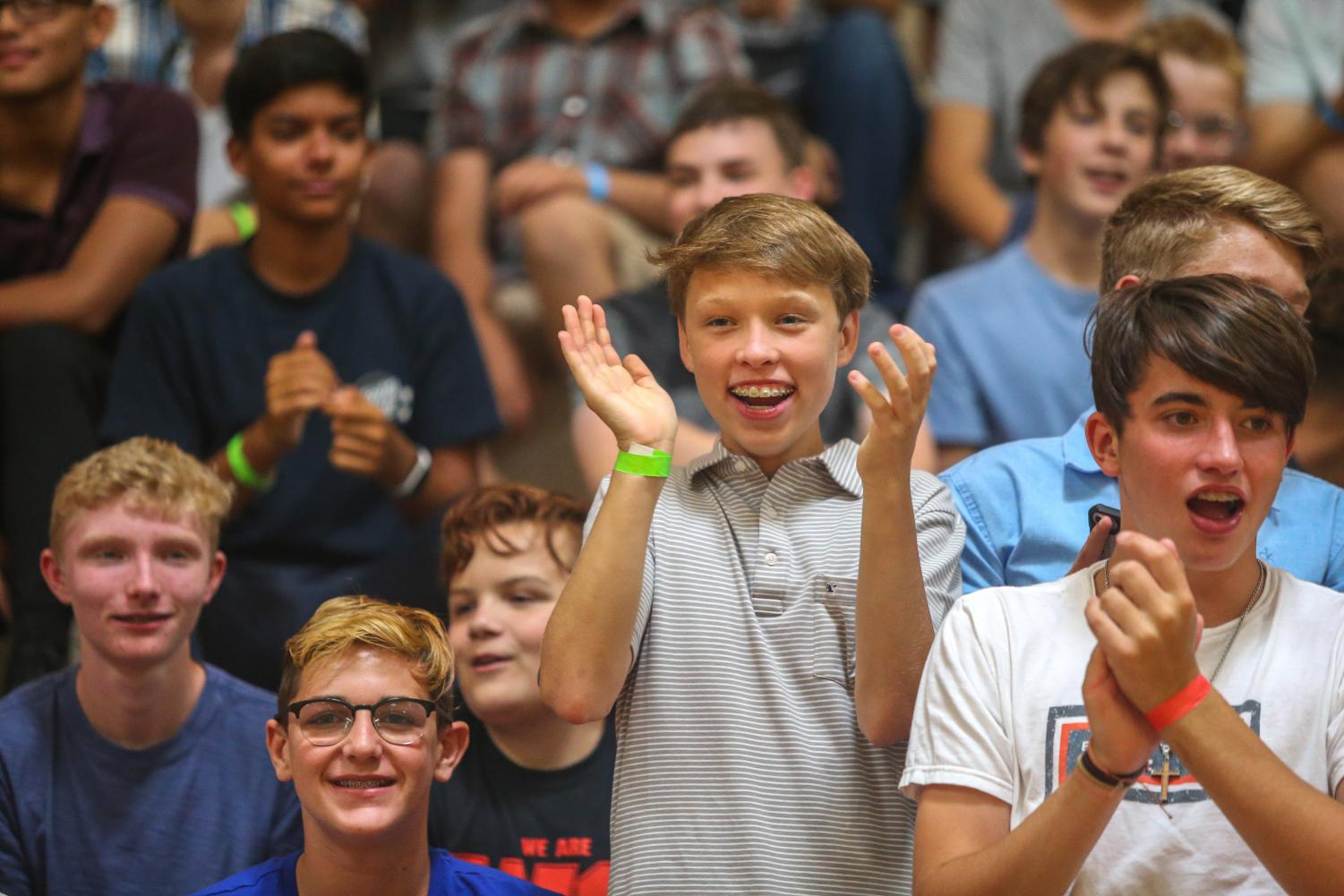 Freshmen Kemper Davis cheers on classmates participating in freshmen activities.
