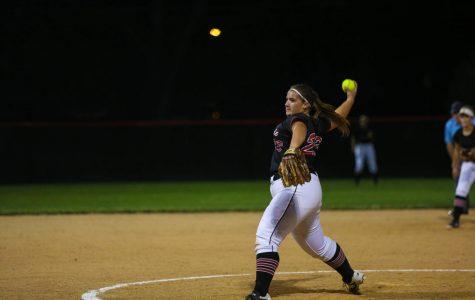 Senior Lana Armsbury pitching at the Westside Vs. Columbus Softball game at Westside High School .