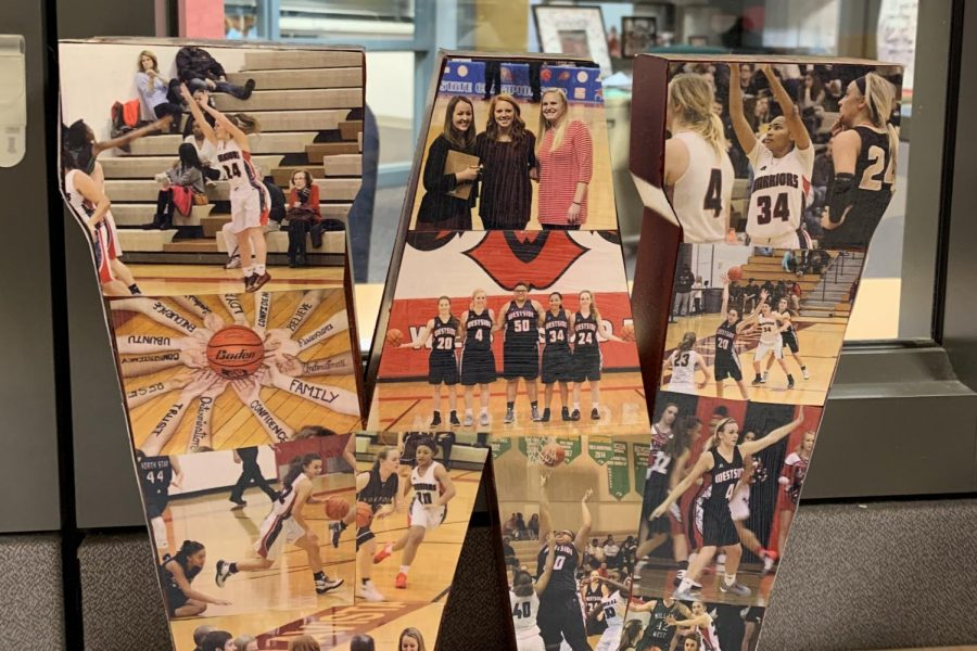 Located at Carlson's desk, this W features memorable moments from her coaching career.