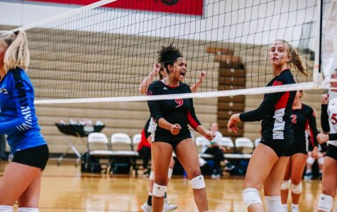 Sophomore Madilyn Siebler and Senior Izzy Nahayo celebrated after scoring a point earlier this season.