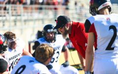 Defensive Coordinator Justin Haberman talks to his team when Westside travelled to Lincoln earlier this season.