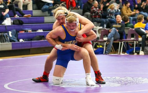 Fifth-ranked sophomore Cole Haberman wrestles against second-ranked junior Gavin Brauer from North Platte High School during the Bellevue East Duals Tournament.