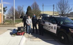 Westside Board of Education Candidate John Brian alongside Omaha Police Officers display the sporting good items collected and donated to Omaha Police Department's PACE organization.