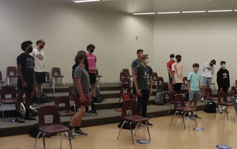 Westside choir students participate in class while wearing required masks.