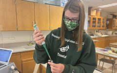 Senior Cassidy Smith uses a pipette during the AP Biology lab.