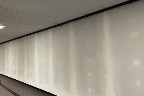 The wall that held old record plaques from the 1970s and '80s is now being replaced with an updated record board that will allow new records to easily be put up over the years.