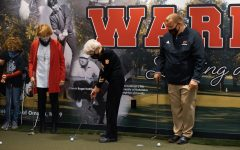 Sally Carlson prepares to take a swing on the Swede Center's putting green.