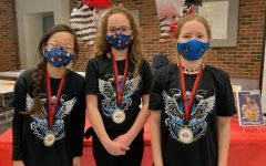 Team members Hattie Cook, Emily Wittrig, and Isabella Higginbotham.