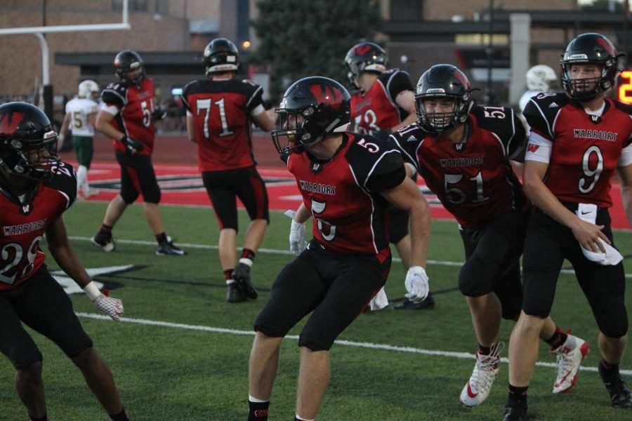Senior Dylan Packett celebrates after making a spectacular touchdown catch