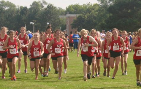 The Westside girls cross country team warms up for a meet earlier in the 2018 season.