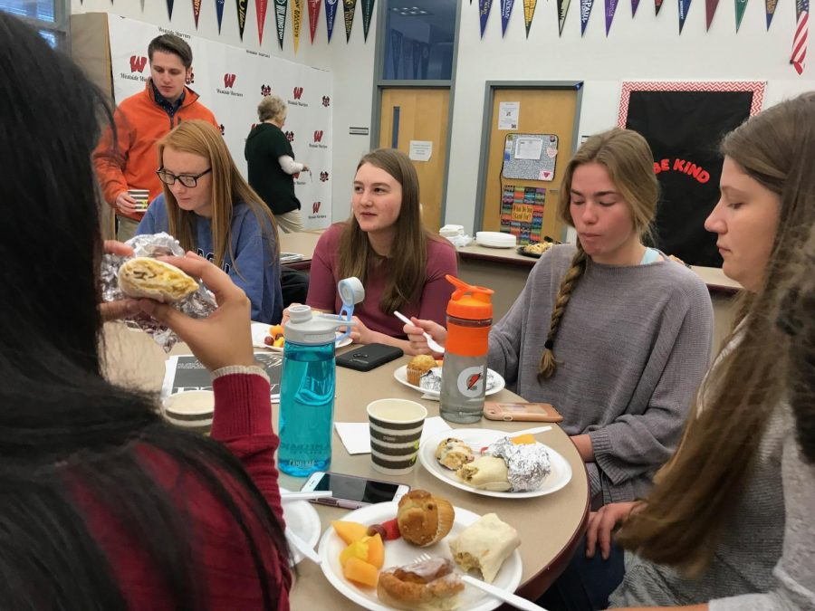 Seniors who received a 30 or above on their ACT attend a breakfast setup by the Guidance Department