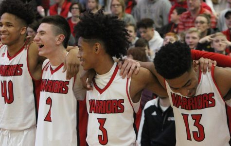 Senior Chase Thompson, Juniors Jadin Booth, PJ Ngambi, and Carl Brown, minutes before the start of the game.