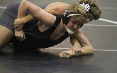 Grueling Practices, Competition Helps Wrestling Team Succeed