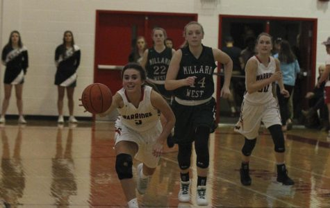 Senior Ryley Nolin chases after a ball during her junior year of her career at Westside.