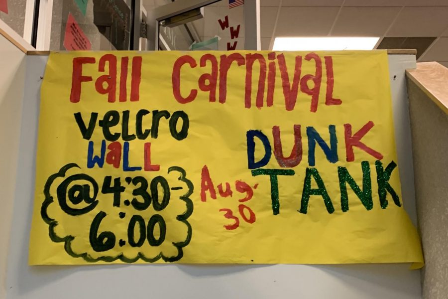 Members of Student Council created and hung up signs advertising the Fall Kickoff Carnival.