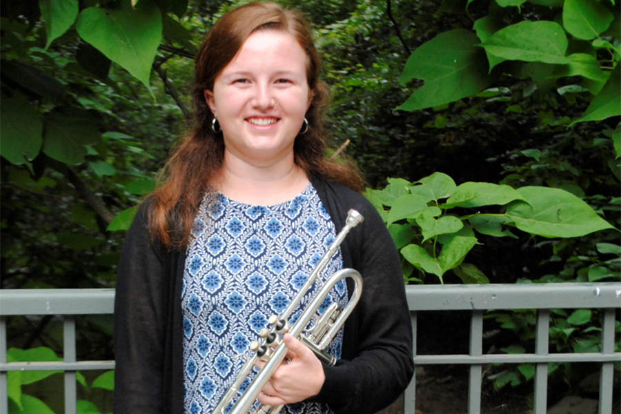 Senior Ashleigh Madsen poses with her trumpet.