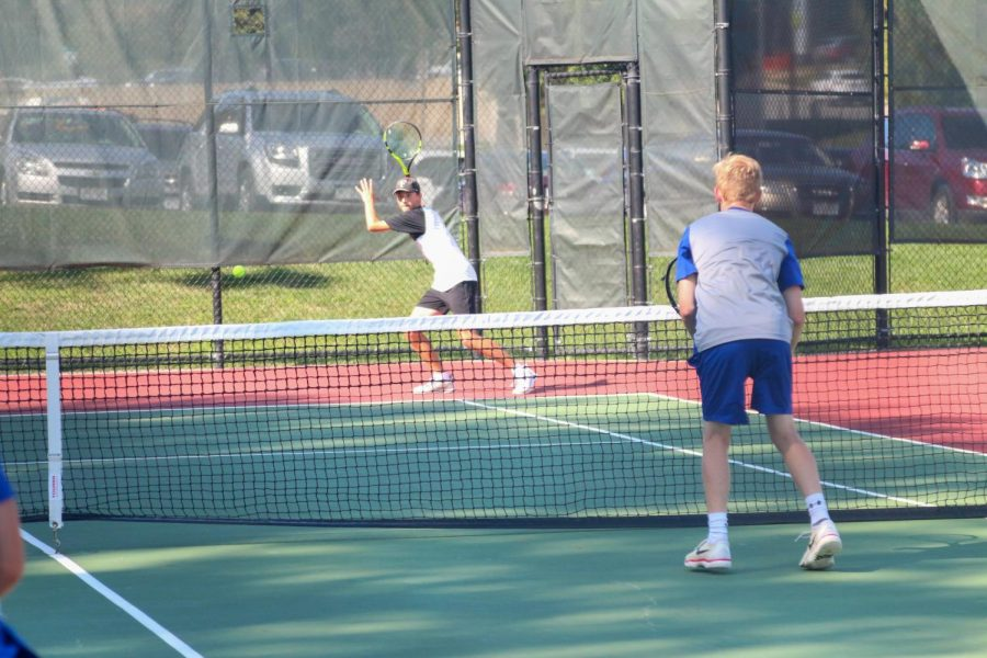Sophomore, Clark Rue hits a powerful forehand in the deep corner in his doubles match against Lincoln East.  Rue and his partner Alex Kugler (freshman) go on to win their match at home.