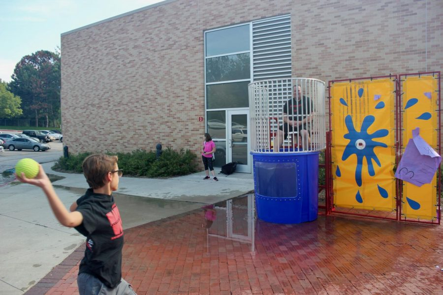 Eighth grader from Westside Middle School attempts to dunk Superintendent Mike Lucas.
