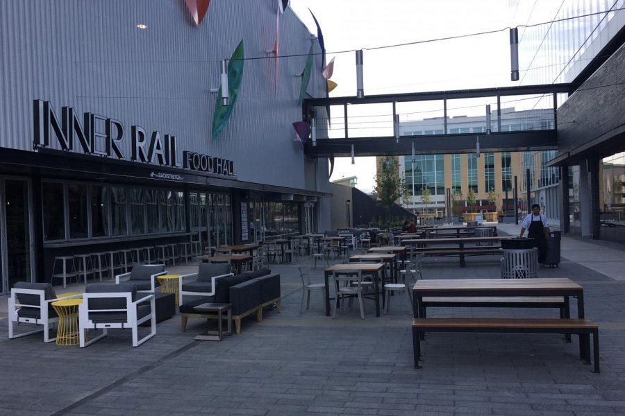 Featured here is the exterior of Inner Rail, showing off its courtyard space with a multitude of seating options and activities to engage in.