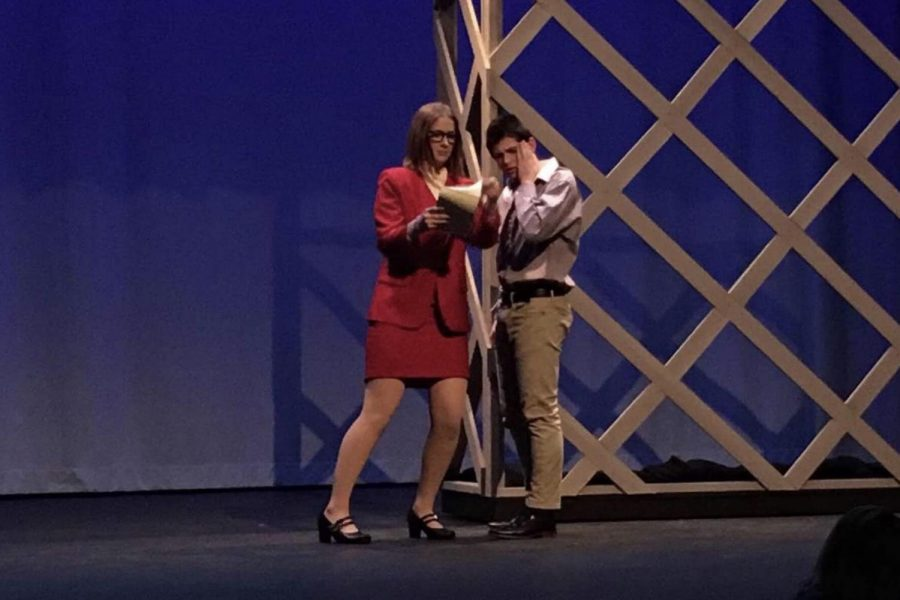 Senior Jill Stark and junior Eliot Gray act out a scene in the fall musical, 9 to 5.