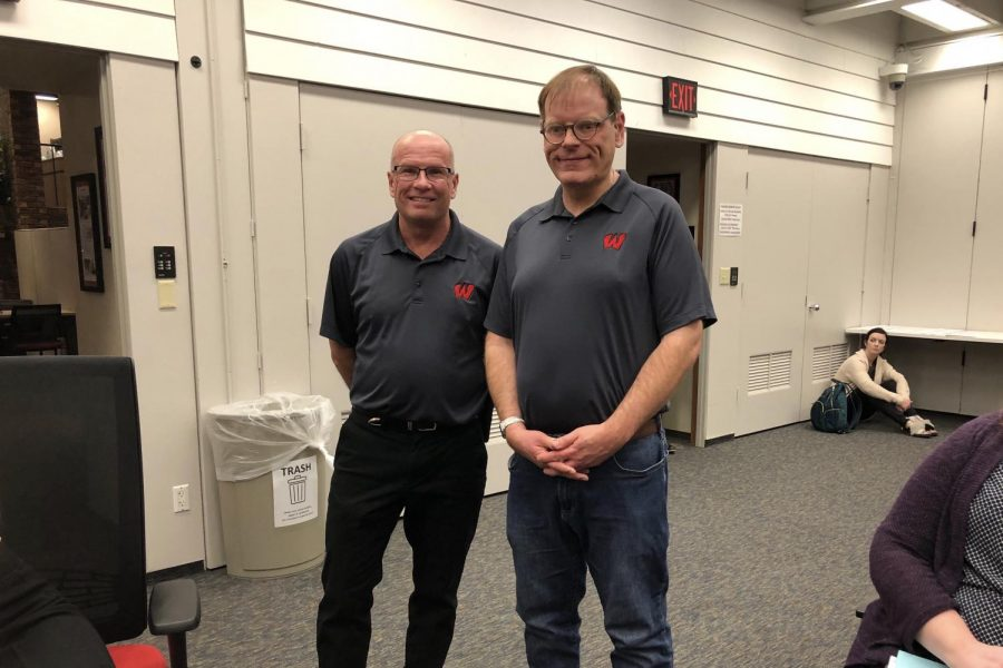Raymond Cich (left) and Chad Kracher (right) work in the print shop at Westside's ABC building and are a partnership that allowed Westside to win the Employer of the Year award.