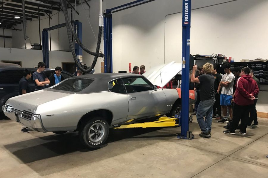 Students inspect a car at Meyers Auto.