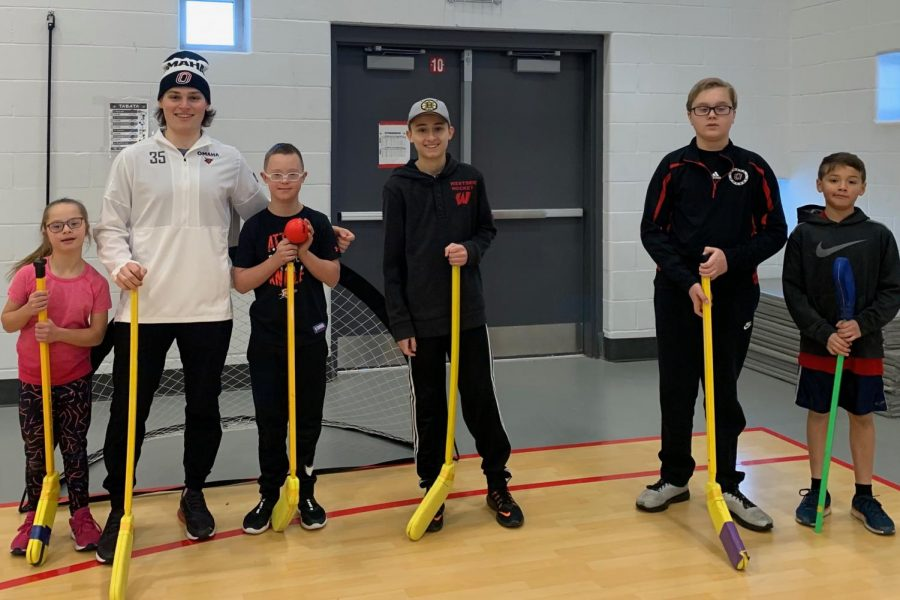 Students who attended the event pose with UNO hockey player Jacob Zab.
