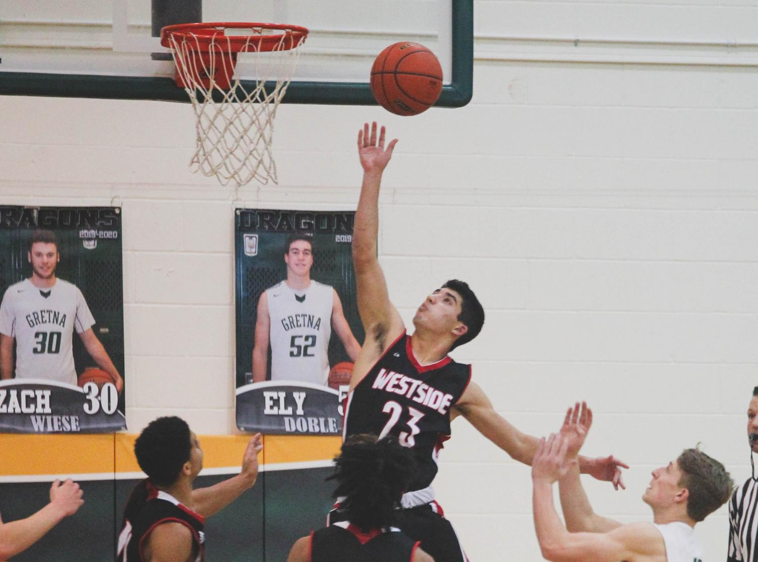 Westside sophomore Dominic Rezac goes to the hoop in a game against Gretna.