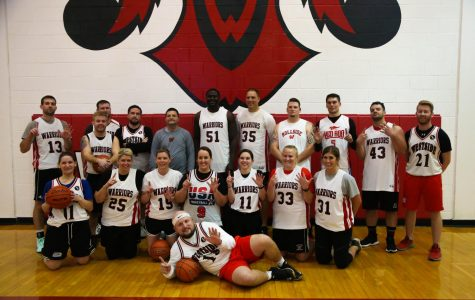 Westside staff who participated in the game, pose for a picture after their win for the sixth year in a row.