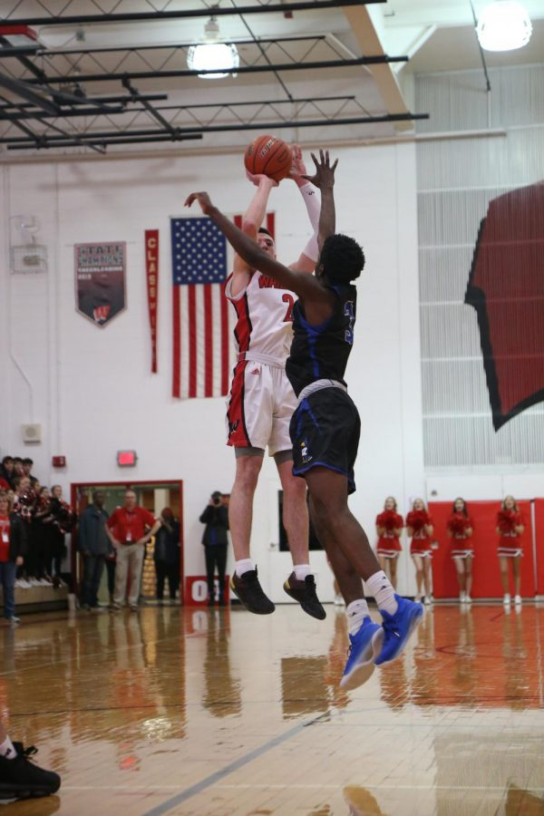 Westside+senior+Jadin+Booth+rises+over+Creighton+Prep%27s+Justin+Sitti+for+one+of+his+six+made+three+pointers+on+Friday.