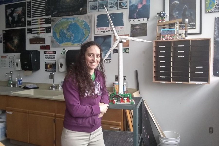 Westside+High+School+science+instructor+Angela+Bergman+poses+next+to+a+model+wind+turbine+used+during+Earth+%26+Space+Science%27s+climate+change+unit.