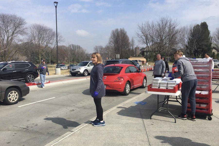Westside community members hand out casseroles to Westside staff at Oakdale Elementary.