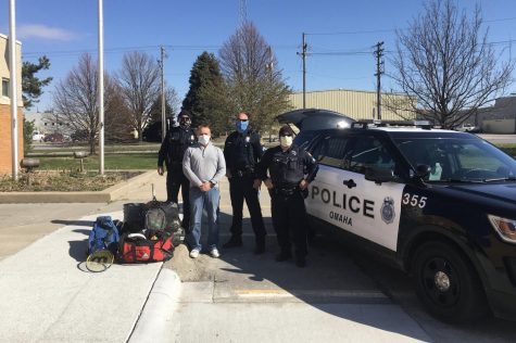 Westside Board of Education Candidate John Brian alongside Omaha Police Officers display the sporting good items collected and donated to Omaha Police Departments PACE organization.
